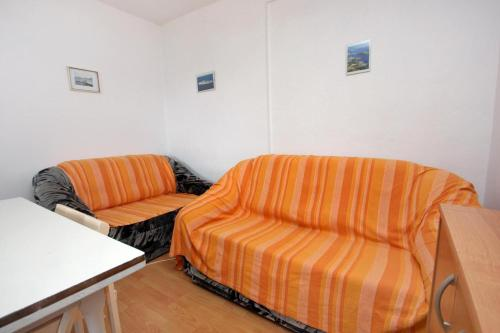 A seating area at Secluded fisherman's cottage Cove Suha Punta bay - Suha Punta (Kornati) - 8168