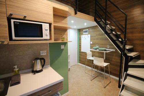 A kitchen or kitchenette at VVP Theme Aparthotel