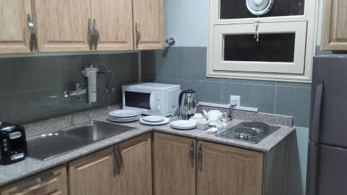 A kitchen or kitchenette at BAHAR HOTEL فندق بحر