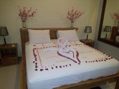 Tempat tidur dalam kamar di Villa Sahabat