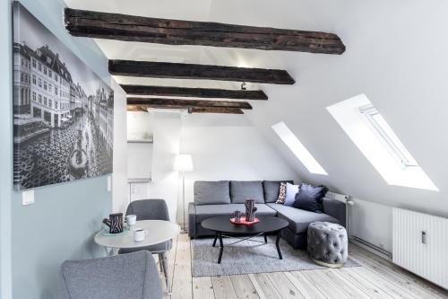 Ein Sitzbereich in der Unterkunft Gammeltorv apartments