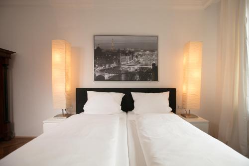Postel nebo postele na pokoji v ubytování Palazzo am Dom
