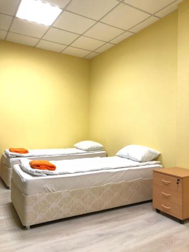 Кровать или кровати в номере Хостел Уютный дом