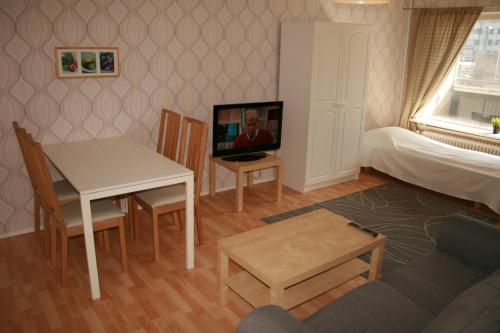 A television and/or entertainment center at Twin bedroom apartment at the heart of Pori! (ID 2981)
