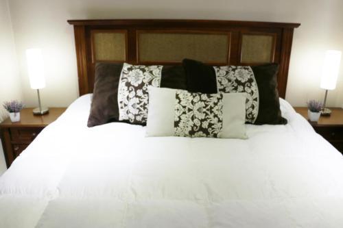 Cama o camas de una habitación en Chile4rent Amunategui 601