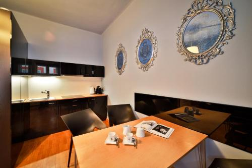 A restaurant or other place to eat at Prague Castle Questenberk Apartments