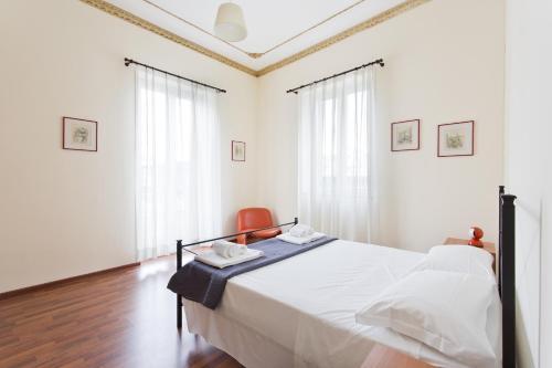 Cama ou camas em um quarto em Nellina's House