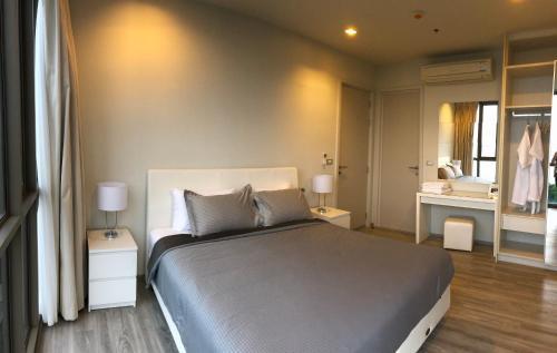 Кровать или кровати в номере Baan Plai Haad Seaview 70 sq.m