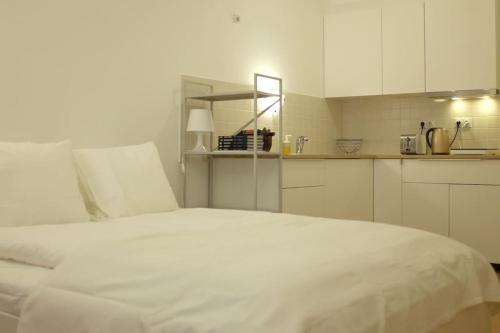 A bed or beds in a room at i Apartments Budapest H25
