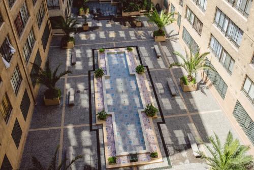 Vista de la piscina de Nexo Optimo Monjitas o alrededores