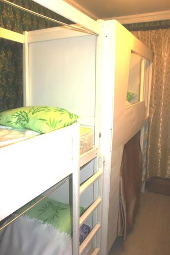 A bunk bed or bunk beds in a room at Hostel U Bashny