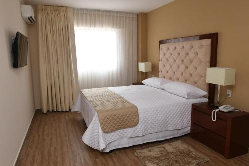 A bed or beds in a room at Taos Apart Hotel