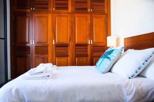A bed or beds in a room at Seaview Famara Beach