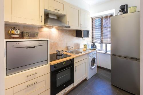 Η κουζίνα ή μικρή κουζίνα στο Holiday Home & Spa - Le Rendez Vous de Vauban