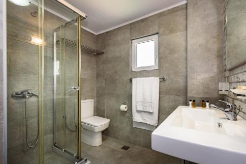 Phòng tắm tại Corinna Mare