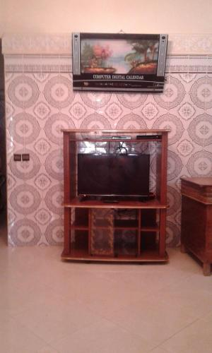 A television and/or entertainment center at jamila appartement