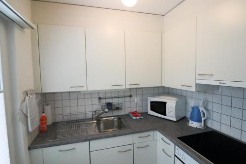 A kitchen or kitchenette at Schiablick - Apt Broggini