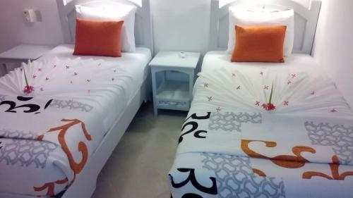 A bed or beds in a room at La Dolce Vita Residence