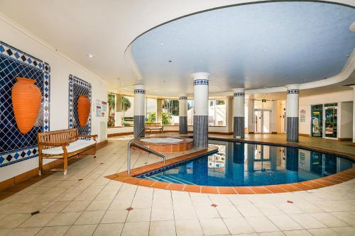 The swimming pool at or near Pelicanstay in Surfers Paradise