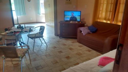 Una televisión o centro de entretenimiento en Temporada Floripa 2019-20
