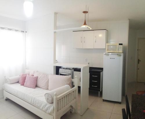 Zona de estar de Apartamento em Canasvieiras