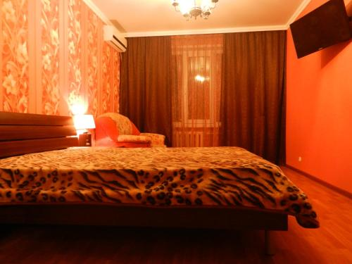 A bed or beds in a room at Chelny Apartments Hotel