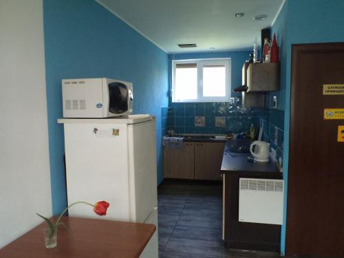 A kitchen or kitchenette at Дом