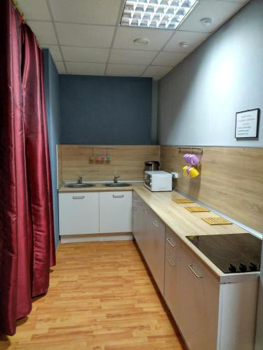 A kitchen or kitchenette at Hostel Tochka