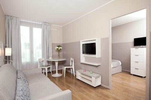 Télévision ou salle de divertissement dans l'établissement Residhome Marseille Saint-Charles