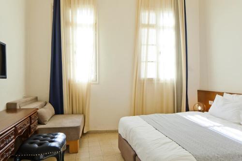 Cama ou camas em um quarto em Cityinn Jaffa Apartments