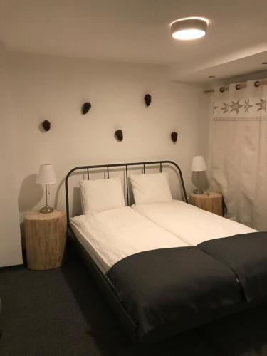 A bed or beds in a room at Apartamenty Sienkiewicza Centrum