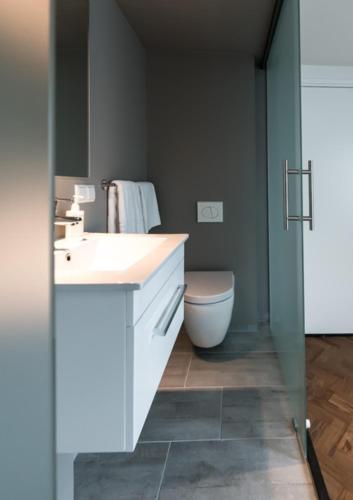 Een badkamer bij Hotel De Bankier