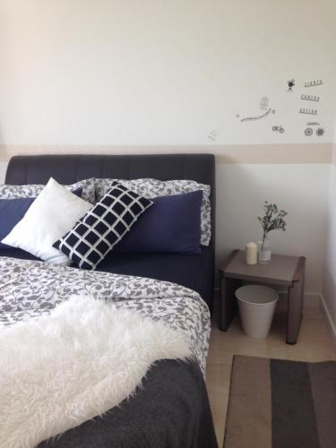 A bed or beds in a room at HAUS The Sentral Residences @ KL Sentral
