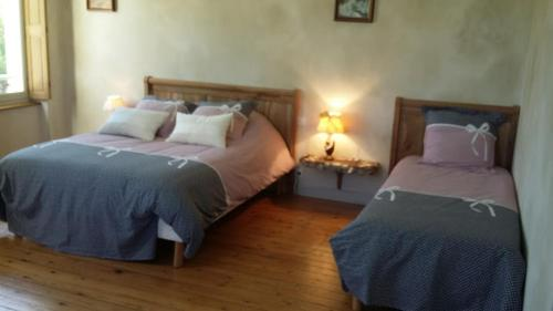 A bed or beds in a room at Domaine des Augers