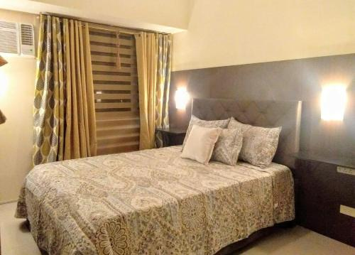 A bed or beds in a room at Mezza 2 Residences