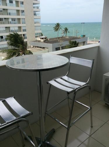 A balcony or terrace at Grenada Ponta Verde Apartamento