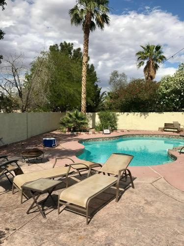 The swimming pool at or near Amazing Henderson Home