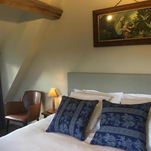 Een bed of bedden in een kamer bij de Gasterie
