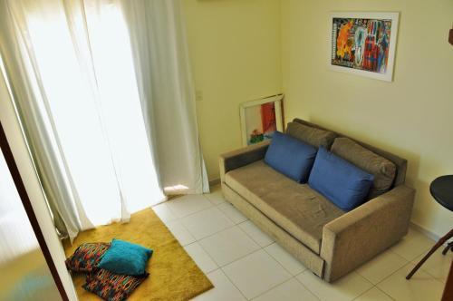 Uma área de estar em Cobertura Relax beach