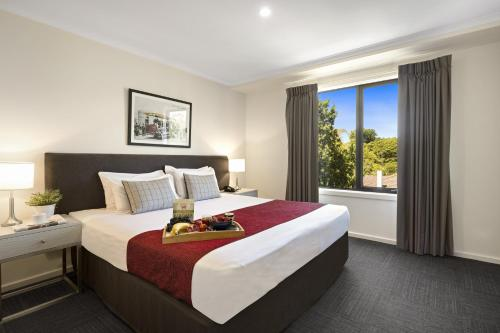 A bed or beds in a room at Quest Mont Albert