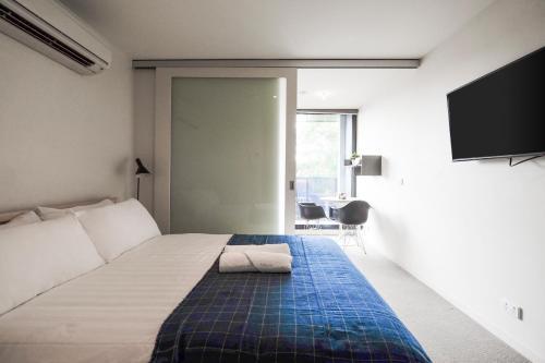 Cama o camas de una habitación en Mono Apartments on Franklin Street