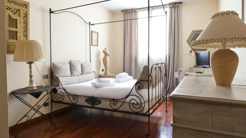 A bed or beds in a room at Italianway-Capecelatro