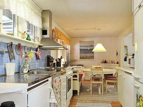 A kitchen or kitchenette at Two-Bedroom Holiday home in Åhus