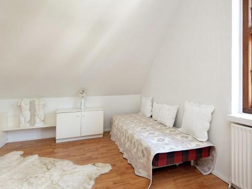 Een bed of bedden in een kamer bij Holiday Home Sverrigsvej