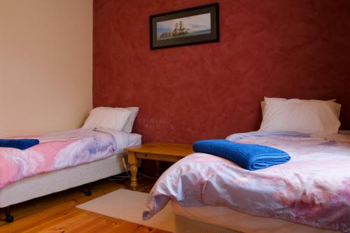 A bed or beds in a room at Gellibrand River Gallery Accommodation