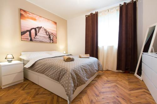 A bed or beds in a room at New rooms & apartments in Ljubljana