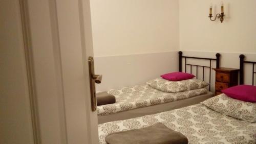 Łóżko lub łóżka w pokoju w obiekcie Apartament MARIA