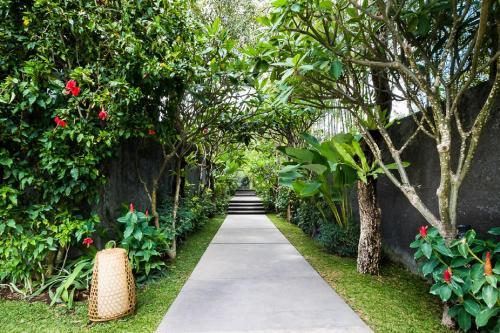 A garden outside The One Boutique Villa