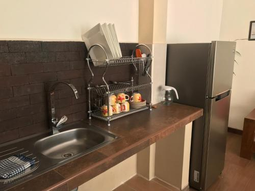 A kitchen or kitchenette at All new apartament