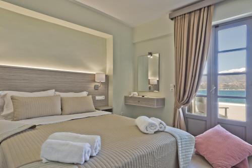 Ένα ή περισσότερα κρεβάτια σε δωμάτιο στο Nereus Luxurious Suites
